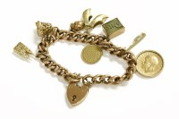 Lot 34 - A gold curb link bracelet with 9ct gold padlock