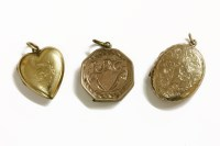 Lot 45 - A gold engraved oval locket with vacant cartouche