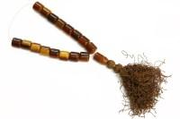 Lot 95 - A single row uniformed parti-coloured Bakelite prayer bead necklace