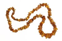 Lot 93 - A single row graduated free form amber bead necklace