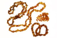Lot 85 - Two single row graduated free form amber bead necklaces