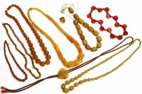 Lot 91 - A single row graduated taper barrel shaped amber early plastic bead necklace
