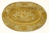 Lot 32-An Arts and Crafts oval brass charger