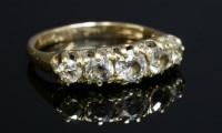 Lot 5 - An Edwardian five stone graduated boat-shaped diamond ring