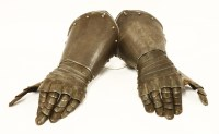 Lot 35-A pair of armour gauntlets