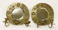 Lot 27-A pair of brass wall mirrors