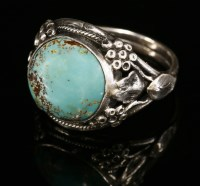 Lot 9-An Arts and Crafts silver single stone turquoise cabochon ring