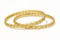 Lot 54 - A pair of Indian high carat gold bangles