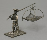 Lot 64 - A silver Fish Seller
