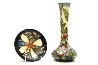 Lot 61 - A Moorcroft bud vase in the Sweet Briar pattern