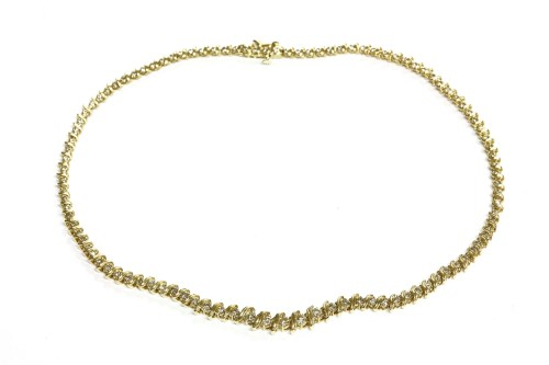 Lot 25-An American graduated diamond set Riviere necklace