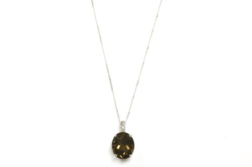 Lot 11-A 9ct white gold smokey quartz and diamond pendant