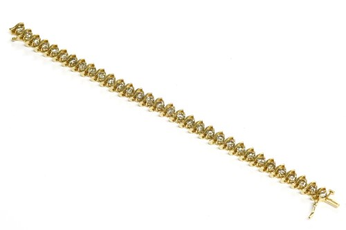 Lot 16-A diamond set line bracelet