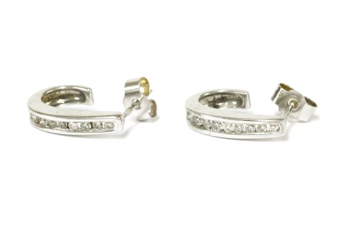 Lot 21-A pair of 9ct white gold diamond set tapered hoop stud earrings