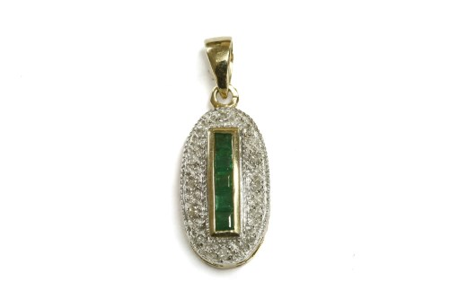 Lot 9-A 9ct gold emerald and diamond oval cluster pendant
