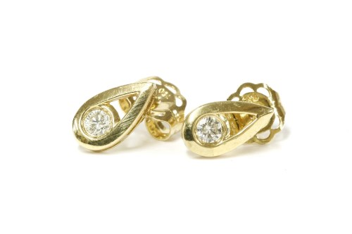 Lot 1-A pair of 18ct gold diamond stud earrings