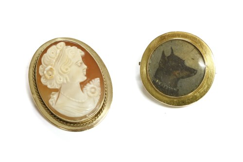 Lot 14-A gold picture locket brooch