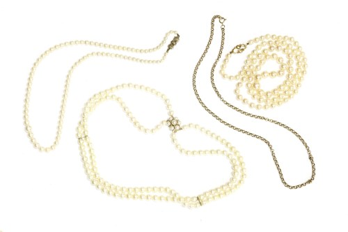 Lot 37-A single row graduated cultured pearl necklace with a 9ct gold bow clasp