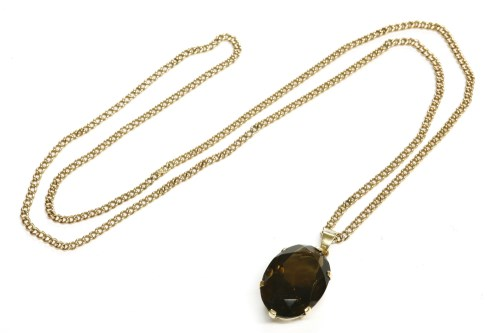 Lot 17-An oval cut smokey quartz pendant