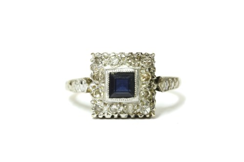 Lot 20-An 18ct gold square cut sapphire and diamond cluster ring