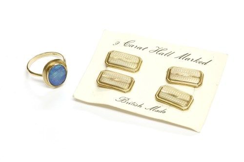 Lot 26-A gold single stone opal doublet cabochon ring