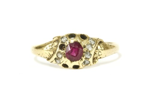 Lot 10-A gold oval cut ruby and rose cut diamond cluster ring