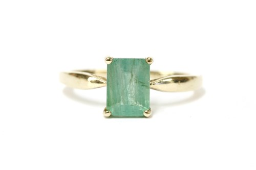 Lot 3-A 9ct gold single stone emerald cut emerald ring