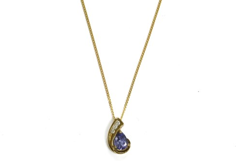Lot 7-A 9ct gold pear shaped tanzanite and brilliant cut diamond pendant