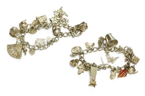 Lot 31-Two silver charm bracelets