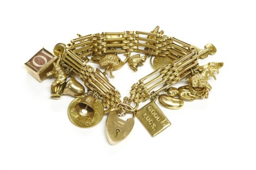 Lot 24-A gold four row gate-link bracelet with padlock