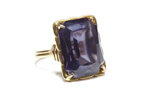 Lot 2-A continental octagonal cut synthetic colour change sapphire ring
