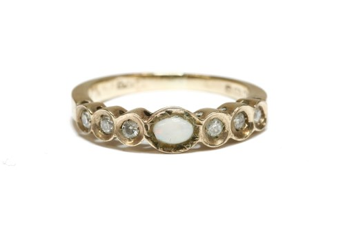 Lot 14-An opal cabochon and diamond half hoop ring