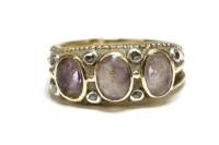 Lot 49-A gold three stone amethyst ring