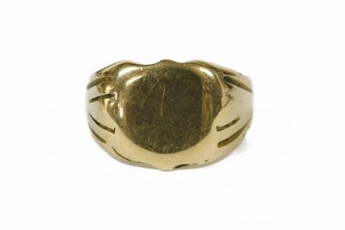 Lot 15-A gentleman's 18ct gold signet ring