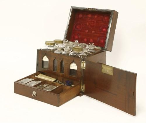 Lot 25 - A George III mahogany apothecary's cabinet