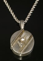 Lot 49-A late Victorian silver hinged locket and chain