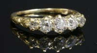 Lot 93 - A late Victorian five stone carved head ring