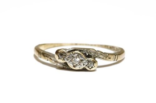 Lot 22-A three stone diamond cross-over ring