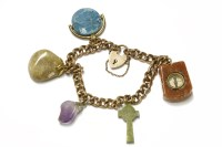 Lot 46-A gold curb link bracelet with padlock and assorted hardstone charms