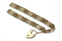 Lot 38-A 9ct gold four row gate link bracelet with padlock