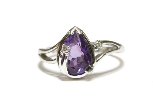 Lot 18-A white gold pear shaped amethyst and diamond points ring