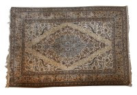Lot 331-An Iranian Isfahan wool and silk carpet