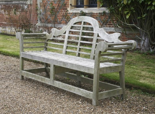 Lot 554-A pair of teak garden seats in the manner of Edwin Lutyens