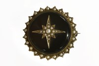 Lot 35 - A Victorian split pearl and black onyx circular brooch