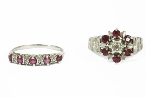 Lot 17-An 18ct white gold illusion set diamond and ruby cluster ring