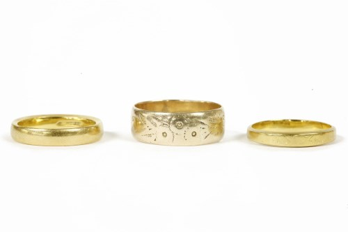 Lot 23-Two 22ct gold wedding rings