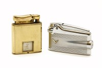 Lot 76 - A Colibri 'Monopol' gold plated lighter with an inset watch movement