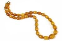 Lot 43-A single row graduated olive shaped amber bead necklace 17.56g