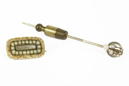 Lot 11-An Art Deco diamond and seed pearl stick pin
