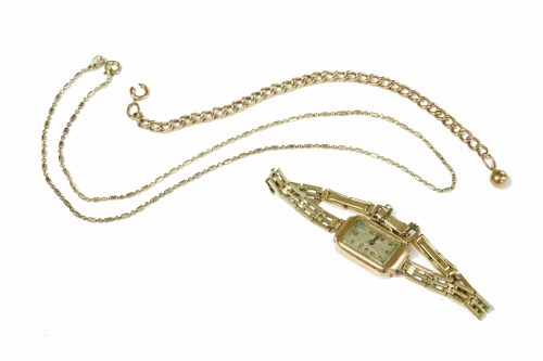 Lot 14-A gold curb link chain with sphere charm